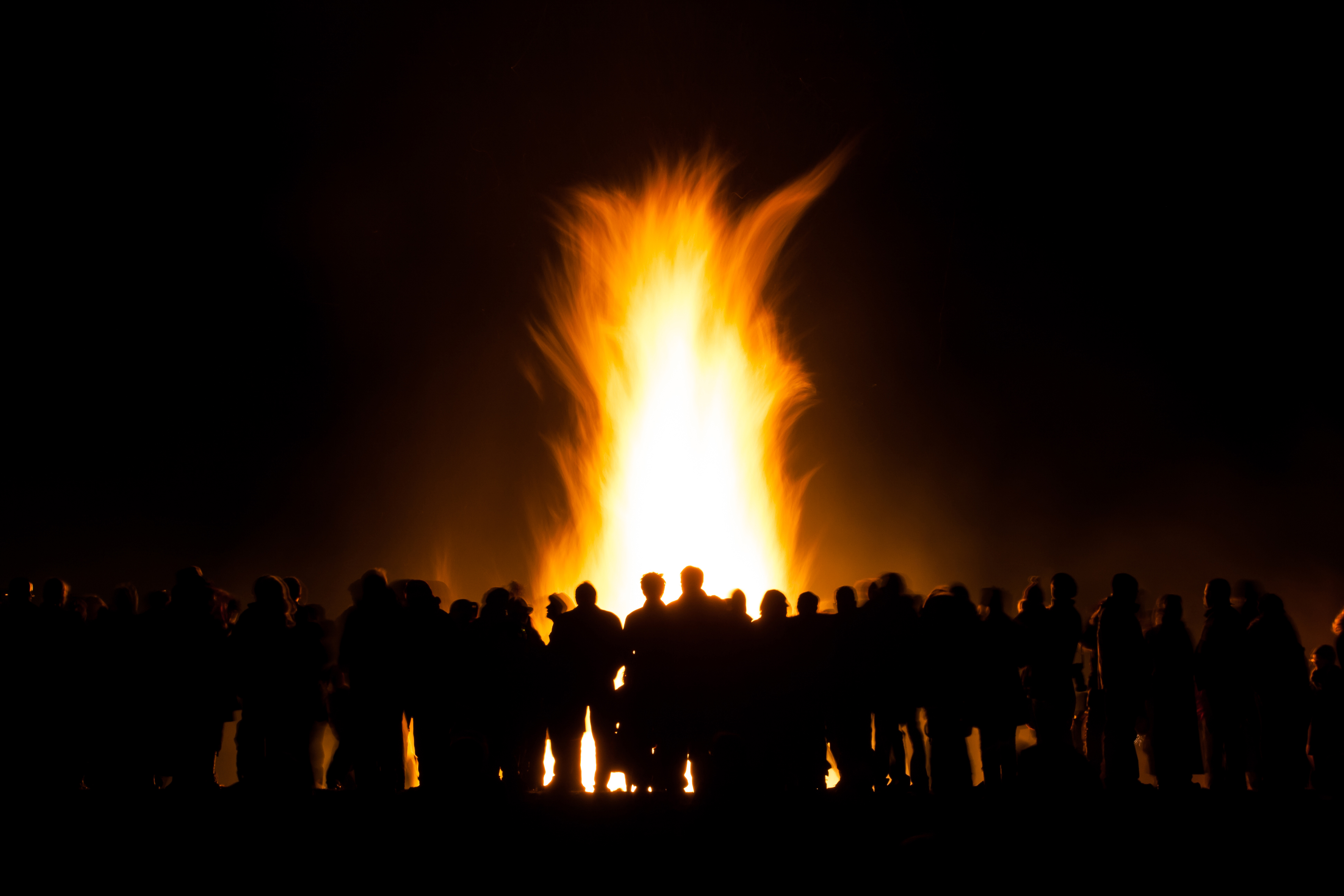 group of people at bonfire